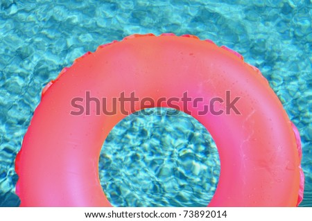 Pool ring / float in swimming pool - stock photo