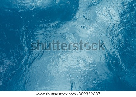 Pool water background with sun reflections - stock photo