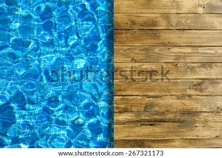 Pool water surface and wooden deck for backgrounds - stock photo