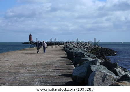 Poolbeg lighthouse and pier - stock photo