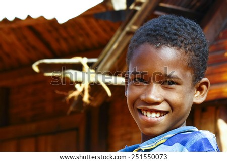 Poor African boy, poverty in Madagascar - stock photo