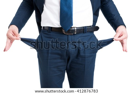 Poor businessman showing empty pants pockets isolated on white background - stock photo