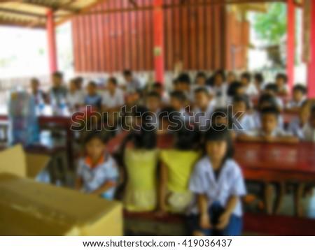 Poor children, Underprivileged children to classrooms in rural Thailand. Blur - stock photo