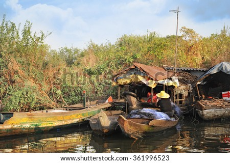 Poor life on a water in Cambodia - stock photo
