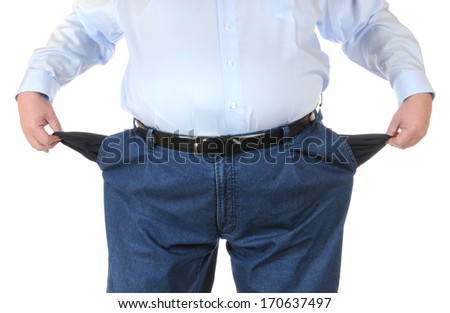 Poor man with empty pockets - stock photo