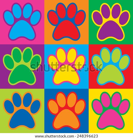 Pop Art animal paw prints in a colorful checkerboard design.  - stock photo