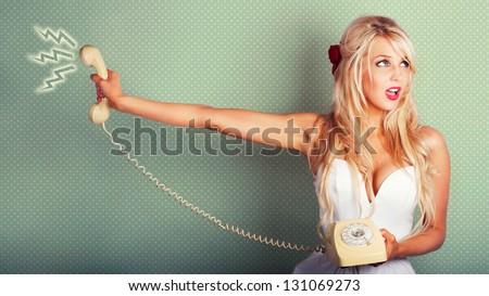 Pop Art Portrait Of A Beautiful Blonde Pin-up Girl On Hold With Call Waiting Music Playing In A Depiction Of Poor Customer Service On Dotted Background - stock photo