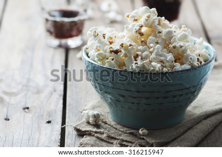 Popcorn and cola on the wooden table, selective focus - stock photo
