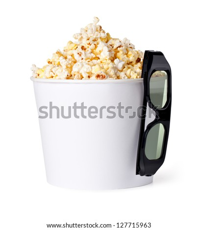 Popcorn and 3d glasses on a white background - stock photo