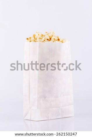 Popcorn bag isolated on white background - stock photo