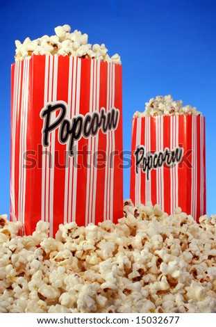 Popcorn bags on blue background - stock photo