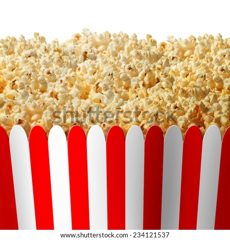 Popcorn box in striped red and white classic container isolated on a white background as an entertainment symbol for preparing to watch an important event on TV or at the movies. - stock photo