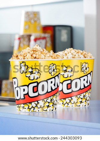 Popcorn buckets on cinema concession counter - stock photo
