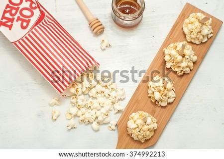 popcorn coated with honey bee,italy - stock photo
