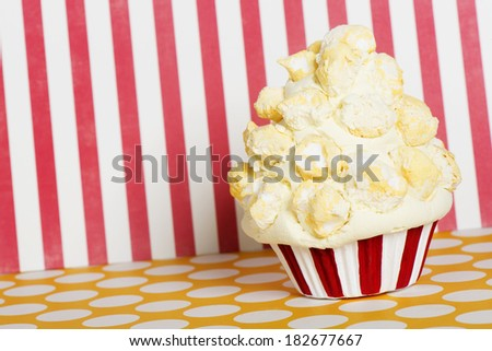popcorn cupcake with red and white liners - stock photo