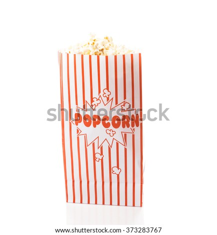 Popcorn in a red and white popcorn bag - stock photo