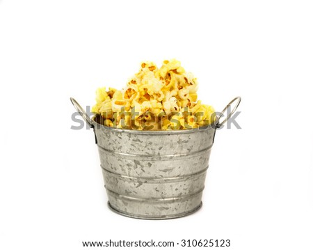 Popcorn in a zinc bucket on white background - stock photo