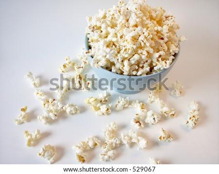Popcorn in Blue bowl - stock photo