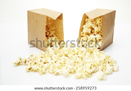 Popcorn in box isolated on white background - stock photo