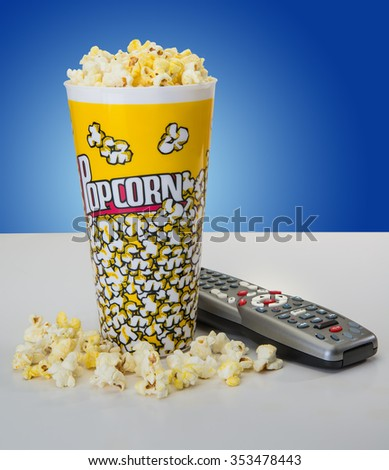 Popcorn in cup for tv movie night - stock photo