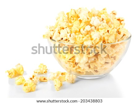 Popcorn in glass bowl isolated on white - stock photo