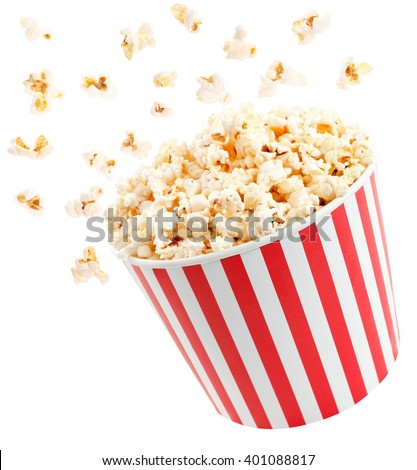 Popcorn in red and white cardboard box is shaking - stock photo