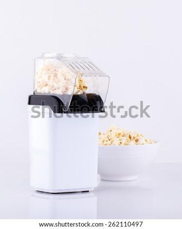 Popcorn making machine isolated on white background  - stock photo