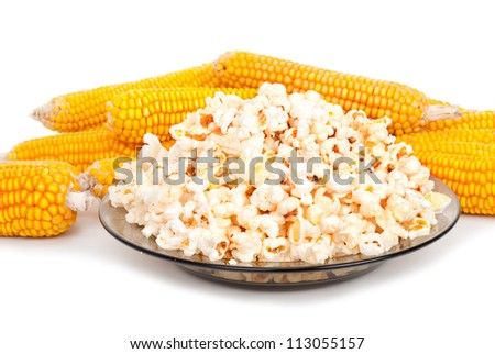 Popcorn on a plate and cobs - stock photo