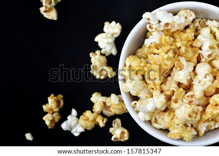popcorn on the black background - stock photo