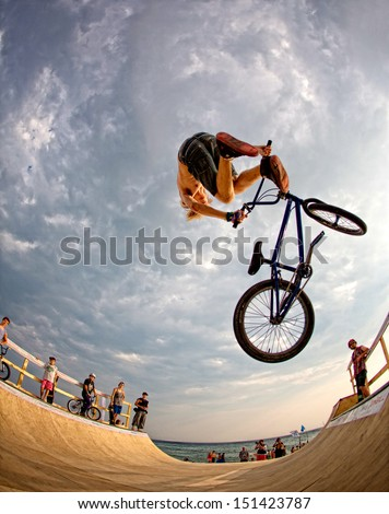 "POPOVKA, UKRAINE - AUGUST 14. Unknown racer on competition of BMX ""Z-Games Spirit of action 2013"" on august 14, 2013 in Popovka, Ukraine - stock photo"