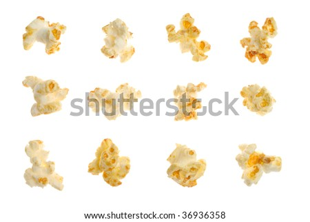 Popped kernels of pop corn snack isolated over white background - stock photo