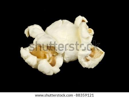 Popped popcorn isolated  on black - stock photo