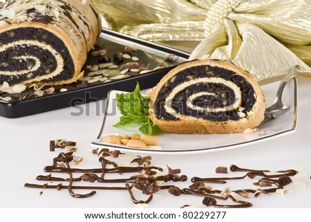Poppy seed cake on decorated table - stock photo