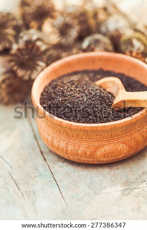 poppy seeds in a wooden bowl on the table - stock photo
