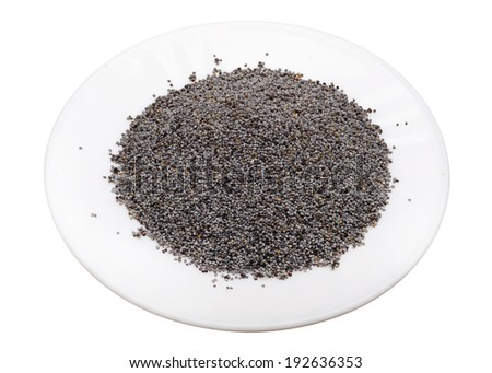Poppy seeds on a white plate, isolated - stock photo