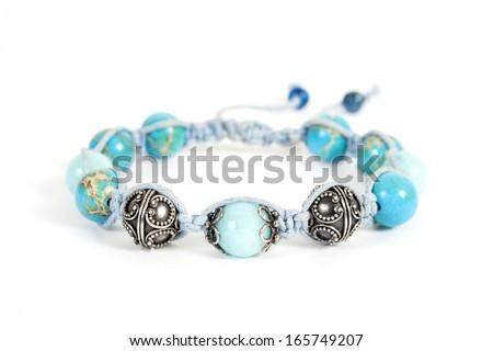 Popular Buddhist bracelet shamballa on a white background.  - stock photo