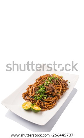 Popular Malaysian stir fried noodles on white plate over white background - stock photo
