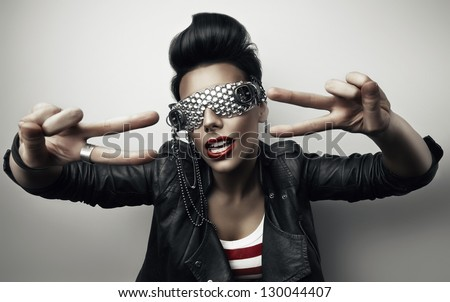 popular woman with creative sunglasses - stock photo