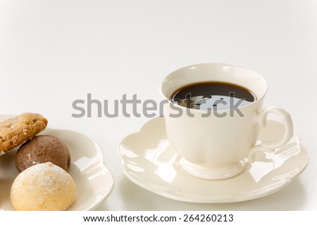 Porcelain coffee cup and tasty cookies  - stock photo