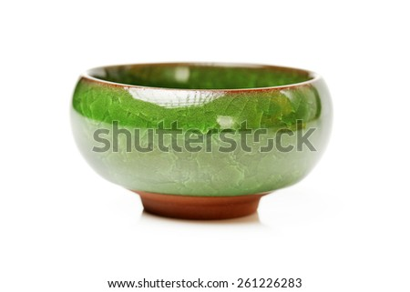 Porcelain cup on white background - stock photo