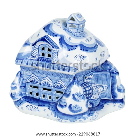 Porcelain souvenir house painted under Gzhel with the traditional pattern, isolated on white background - stock photo