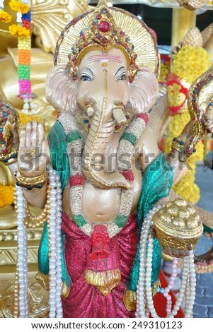 Porcelain statue of Ganesh. Hindu elephant-headed god. - stock photo