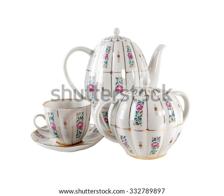 Porcelain teapot, teacup and sugar-bowl with floral roses ornament in retro style isolated over white background - stock photo