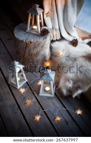 Porch decorated with lanterns and Christmas lights - stock photo