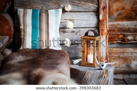 Porch decoration with lantern and reindeer antler - stock photo