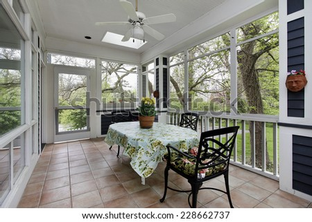 Porch in suburban home with tile floor - stock photo
