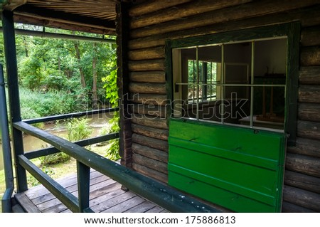Porch of the empty wooden house in forest - stock photo