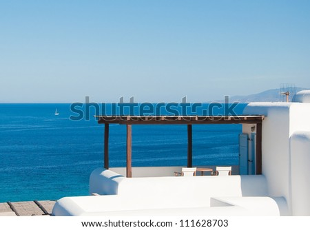 Porch with a shed in the house with a sea view. Greece. Mykonos. - stock photo