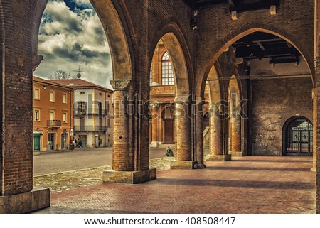 porches with arches and columns in the main square of Rimini in Italy - stock photo