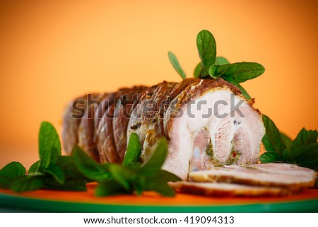pork baked with spices and mint  - stock photo